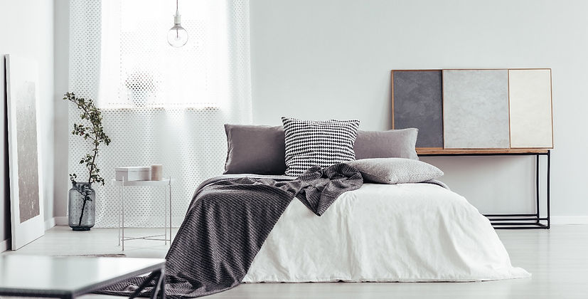 Cozy bedroom with linen in grey shades