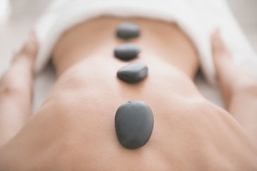 Hot stones on woman's back