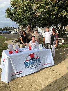 RAFTS Volunteers at table.jpg