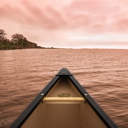 Canoe on the water by Canadian Kelsey