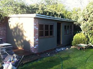 garden room project rendered brick