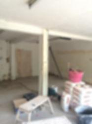 plastering a shop