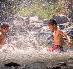 74700437-children-playing-in-the-river-_edited_edited.jpg