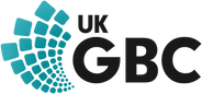 The image is the logo for the UK Green Building Council. On the left is a series of skewed stacked squares and on the left is UK on top of GBC in black text.