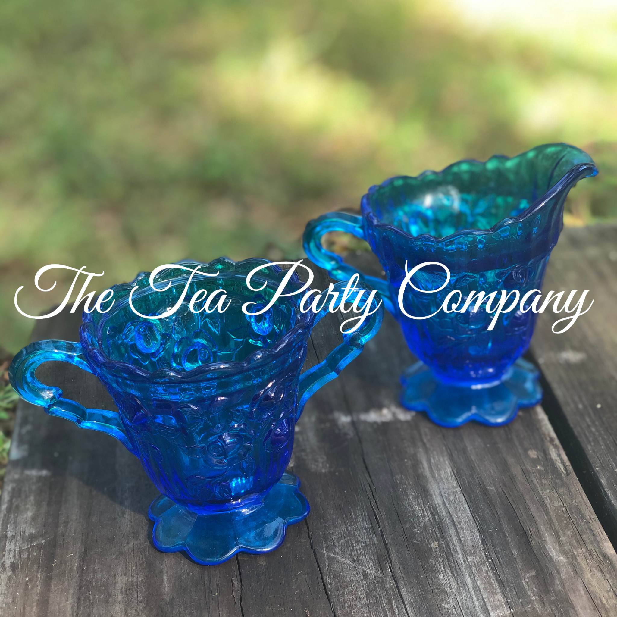 Blue Glass Creamer and Sugar Bowl The Te