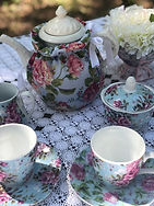 blue fabric roses pttren teapot cozy with blue and pink roses creamer and sugar bowl blue and pink roses tea cup and saucer mothers day tea party the tea party company