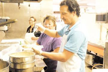 Lizzy's Kitchen, Caring Hearts team up to feed 560