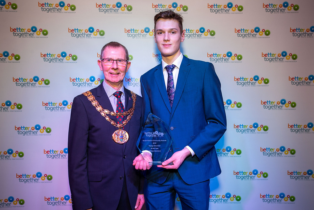 Will Bamford receiving his Young Volunteer of the Year Award from South Ribble Mayor, Coun Harry Hancock, at the South Ribble Council Community Awards