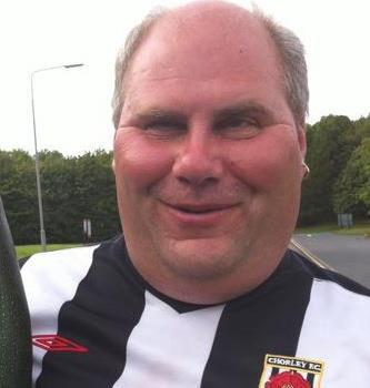 Full facial shot of Matt Bagot wearing a black and white Chorley FC football shirt