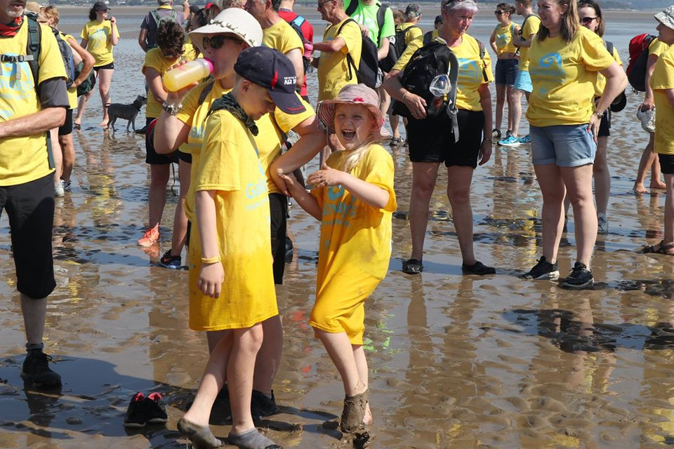 Children splashing and having fun in the sea in Morecambe