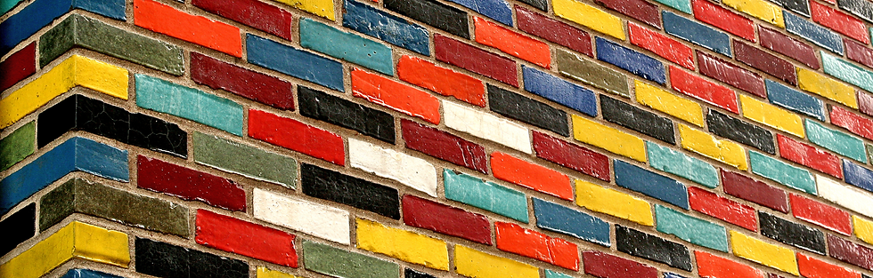 Picture of a wall of multicoloured brick