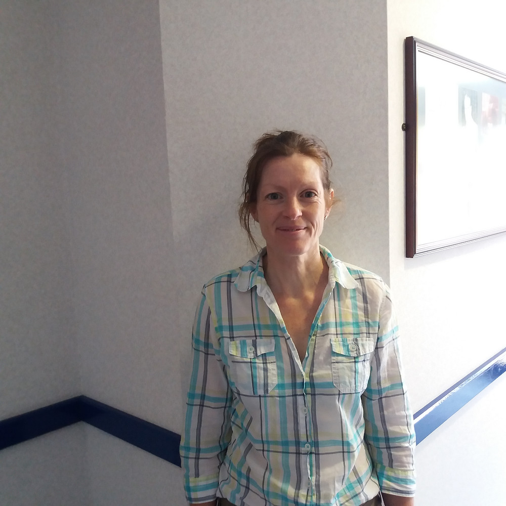 Photo shows Caroline wearing a checked shirt, stood in one of the Galloway's centres