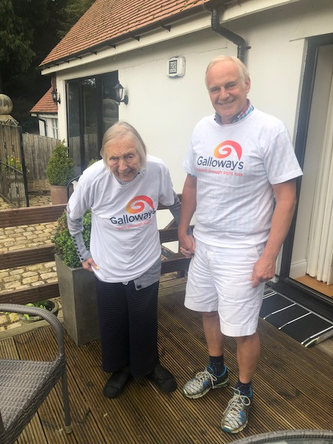 Photo shows Mavis Booth and Simon Booth stood up on decking outside. They are both wearing white Galloway's T-shirts