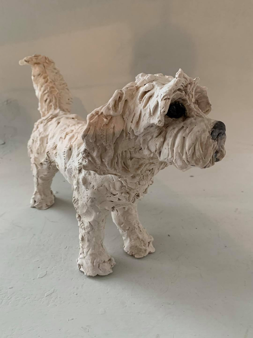 Photo shows a white ceramic dog