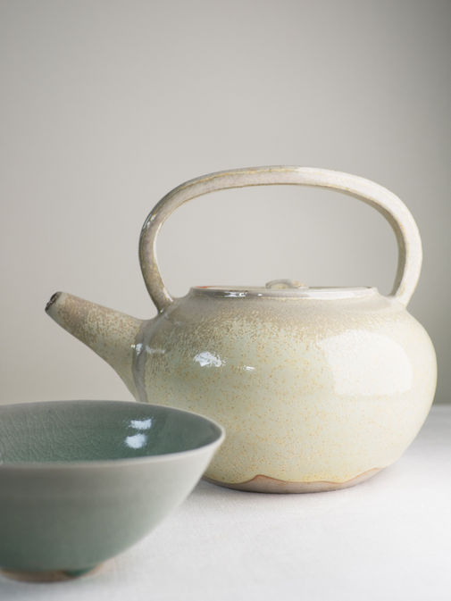 Sand colored teapot and cup. Stoneware. 10h; 9x5