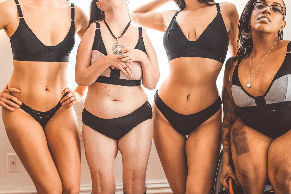 Four women in adaptive clothing pose with only their busts showing.