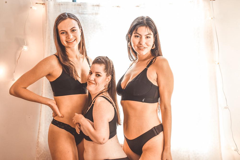 three women pose in adaptive clothing