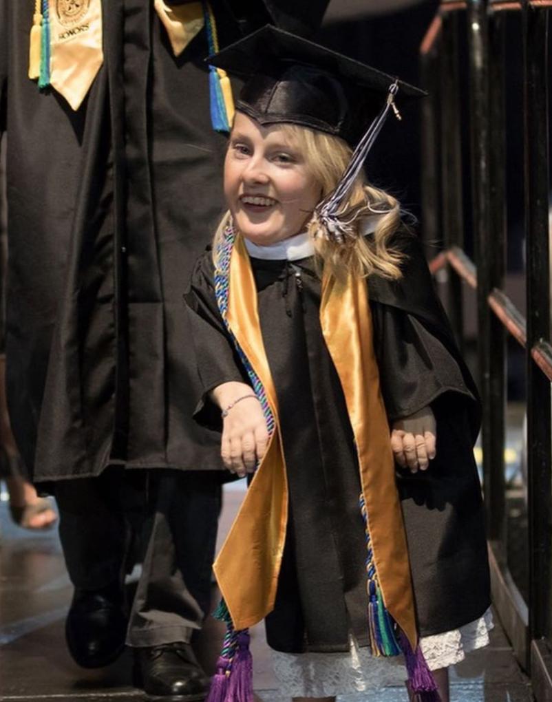 dwarf-disability-graduate