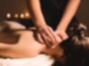 Men's hands make a therapeutic neck mass
