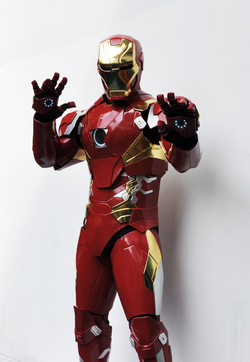 Ironman costume sideway with palm