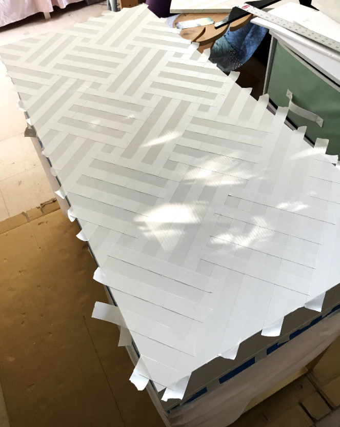 artist's tape for stencil pattern on desk