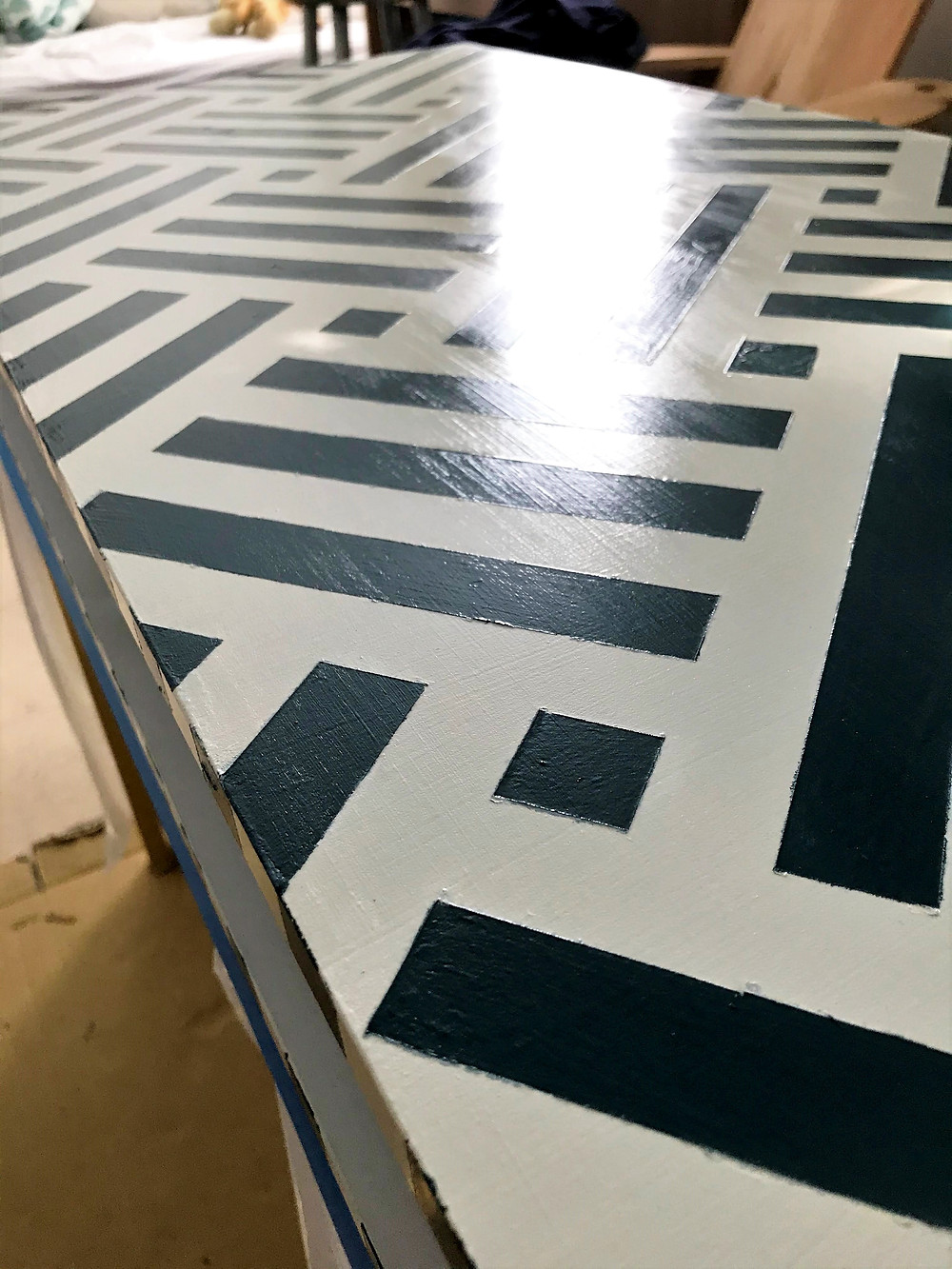 applying acrylic gloss varnish or finish on wood desk with chalk paint design striped pattern