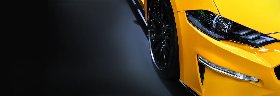 Front headlights of yellow modern car on black background,copy space.jpg