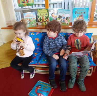 Enjoying books on our new sofas