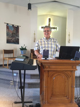Andy preaching smiling.JPG