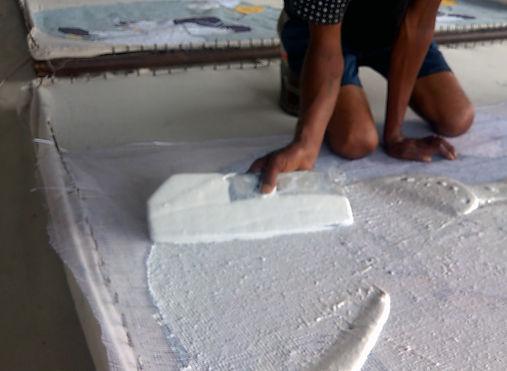 Latexage dos tapis tufté