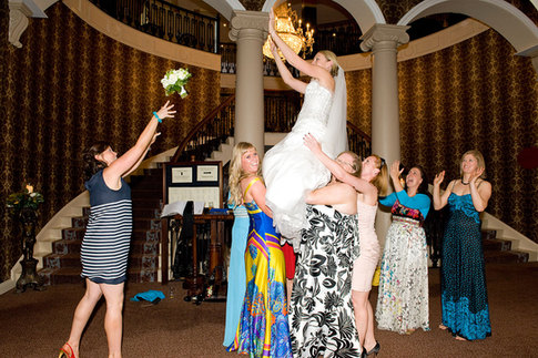 fun wedding photography catching the bouquet