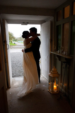 natural style wedding photograph of couple kissing