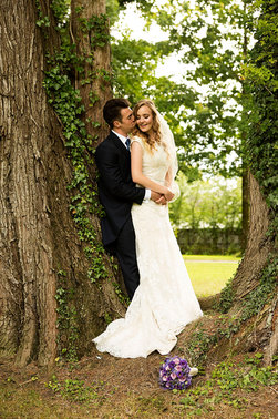 romantic wedding photograph of couple in natural setting