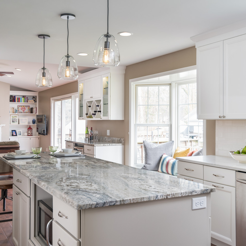 White painted kitchen cabinets and quartz countertops