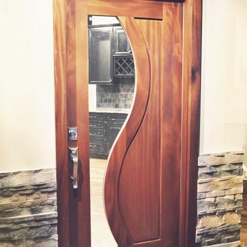 Custom interior wood and glass door sold by The Woodsmiths in Kalamazoo, MI.