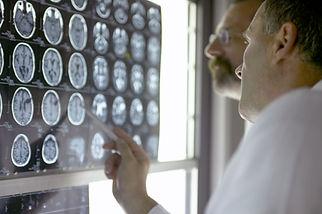 Doctor Analyzing X-Rays