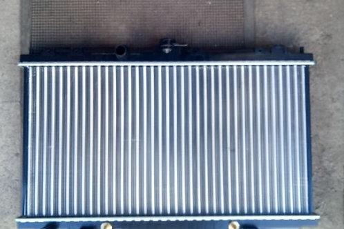 Радиатор охлаждения Ниссан Примьера Р12, Альмера, Вингроад  21460AV700