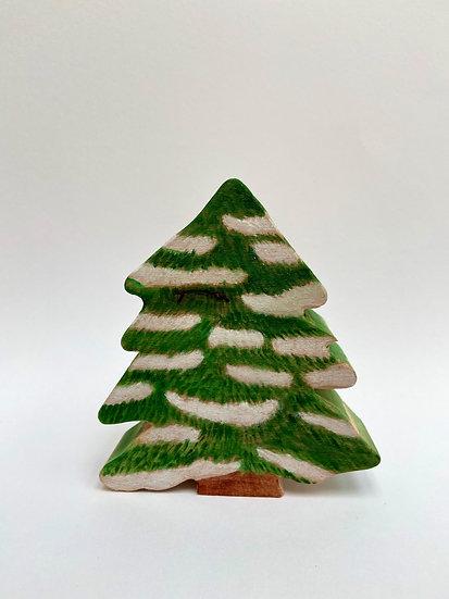 Small snowy fir tree