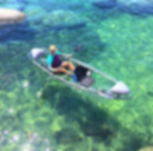 One of our beautiful customers making one of our clear kayaks look REAL good.