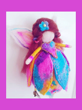 Hand-made Custom Wool Fairy with Felted Skirt and Rainbow Charm Pinks Purples Yellows and Blues
