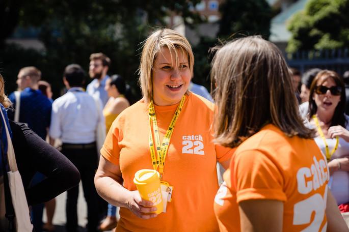 orange volunteer tshirts with Catch22 logo