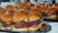 A_party_tray_of_sliders_at_a_restaurant.
