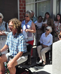 Many people gathered in outdoor courtyard to watch groundbreaking