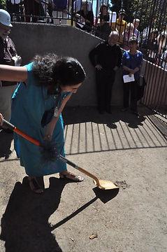 Dr Ellen Beck using shovel to break ground