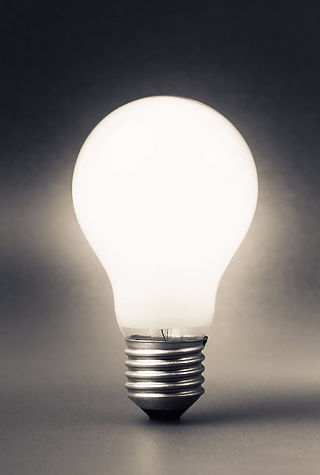 white lightbulb with jar of lightbulbs_edited.jpg