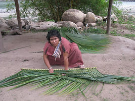 Peru-woman-weaving-palm-leaves.jpg