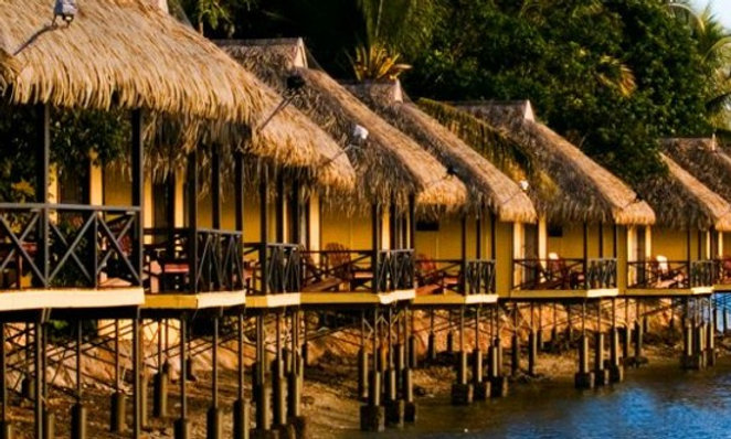 CUSTOM SYNTHETIC THATCH AWNINGS