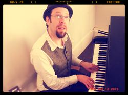 Adam Michael Rothberg at piano