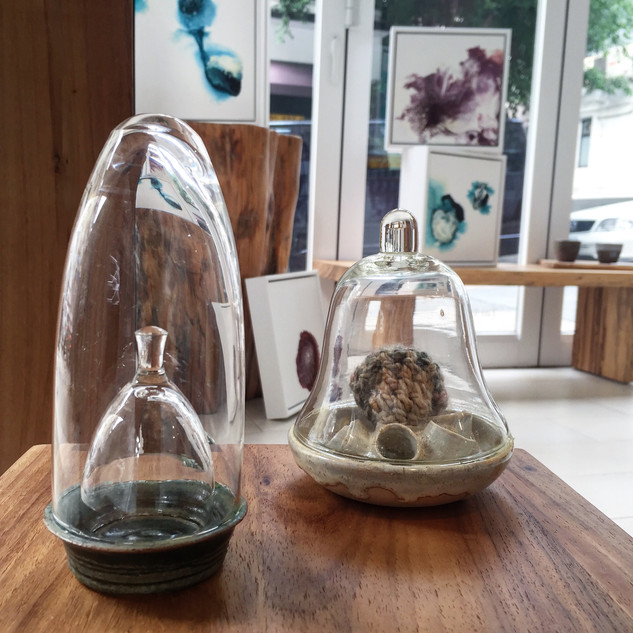 (Left) Allyson Adeney 'Oxide Double Dome', 2018. Stoneware, glass 3cm x 5cm  (Right) Allyson Adeney 'Shino White Dome with knitting', 2018. Stoneware, knitting, glass 5cm x 4cm