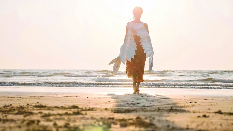 Beautiful-female-angel-walking-barefoot-